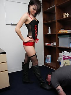 12 of Maggie gets her boots kissed by her slave