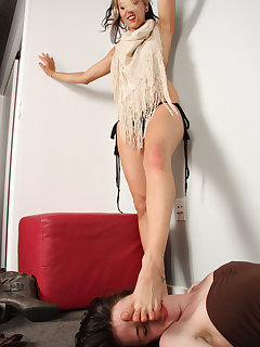 12 of Dahlia crushes her bare feet on slave girl's face