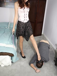 12 of Crushing her shoes on slave's hands while he licks them