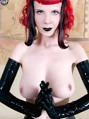 Gothic girl in black latex gloves