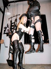 Two Mistresses playing with their slave: cbt, footdom, strapon