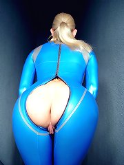 Blonde in blue latex on stairway