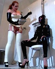 This lovely latex creature is held hostage by a lady called Dr. Anders