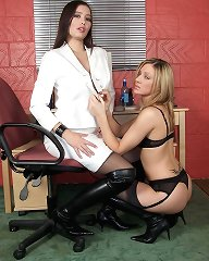 The office is the perfect place for these leather loving lesbians to play