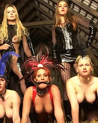 Five gorgeous latex hoes explore each others fuck holes in an old barn house
