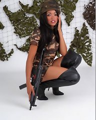 Horny Natasha has her military dress on and some leather boots