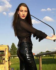 It\'s a warm summer day and Lady K. takes her latex slave for a walk