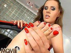 Zuzana pampering her stockinged legs in sport car