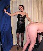 Hot mistress punishing male slave