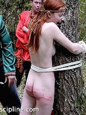 A girl brutally caned somewhere deep in the woods