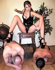 Mistress dominate two slaveboys