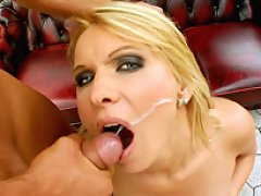 Busty blonde MILF gets banged by two guys and takes a facial