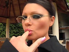 Sexy brunette with glasses facesit and gets fucked outdoors on leather chair