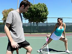 Voluptous MILF seduces young man on the tennis court