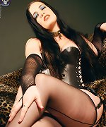 Goth in corset stockings heels fucks self with dildo