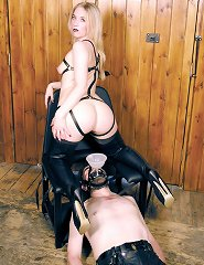 Mistress Sidonia revels in her glory with a slave at her feet.