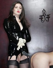 Mistress Darla forces her slave to take it up the rear.