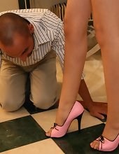 The lady gets her feet kissed