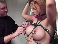 Busty babe gets a nipple flogging