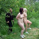 Master humiliated two female slaves outdoor