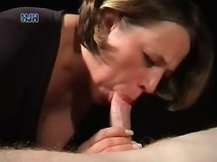 Short haired babe strokes a cock