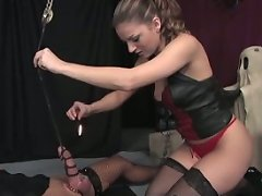 Mistress Lydia pours hot wax all over her slave's nipples and cock and balls...among other indignities and pain she inflicts