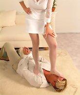 Mistress in pantyhose tramples man.
