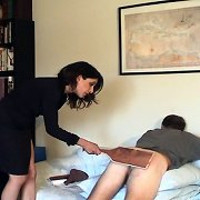 Femdom in black gives his ass a hard beating
