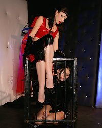 Very hot caged lesbian spanked by her latex mistress hard