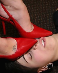 Mistress in red heels trampled female slave