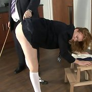 Teacher punishes a schoolgirl by shoe