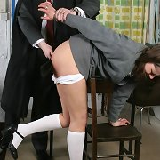 Teacher spanks bad school girl in the class