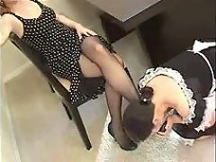 A maid worshipped the nyloned feet