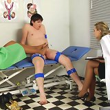 Jerking medical examinee gets footjobbed