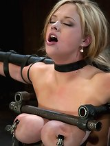 Big titted bitch bound on a sybian and made to cum over and over, metal breast bondage!