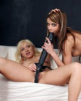 Chicks riding strap on dildo