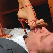 Stunning busines lady tramples employee with high heels in office