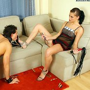 Disobedient slave licking mistress's beautiful feet for being a bad boy