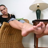 Barefoot mistress smokes a cig while playing with her crop whip in front of cameras