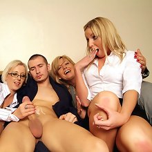 Two young girls learn from some MILFs how to play with a man\\\'s cock