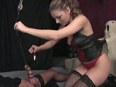 Mistress Lydia pours hot wax all over her slave\'s nipples and cock and balls...among other indignities and pain she inflicts