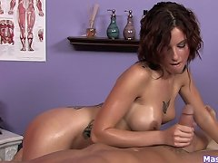 A great oily handjob-titjob by a bust..