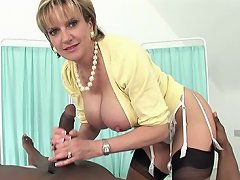Mature milking a huge black cock