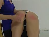 Lesbian babe gets her cheeks spanked otk