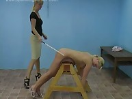 Caning action with two hot blond babes