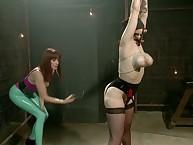 Strict mistress spanks lesbian girl