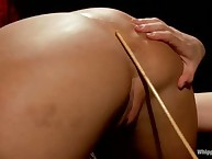 A slave was chaned and flogged to her hot ass
