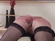 Immoral milf was caned on sofa