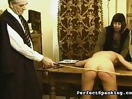 Old headmaster thrashing disobedient schoolgirl