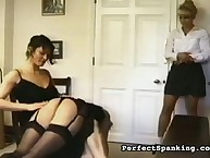 Cruel mistress spanked two babes